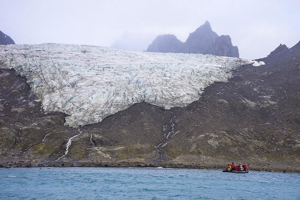 Tourists on a zodiac watching a glacier on Elephant Island, South Shetland Islands, Antarctica, Polar Regions