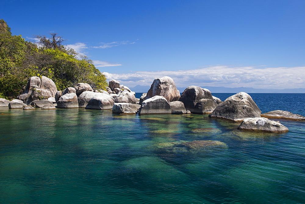 Turquoise clear water and granite rocks, Mumbo Island, Cape Maclear, Lake Malawi, Malawi, Africa