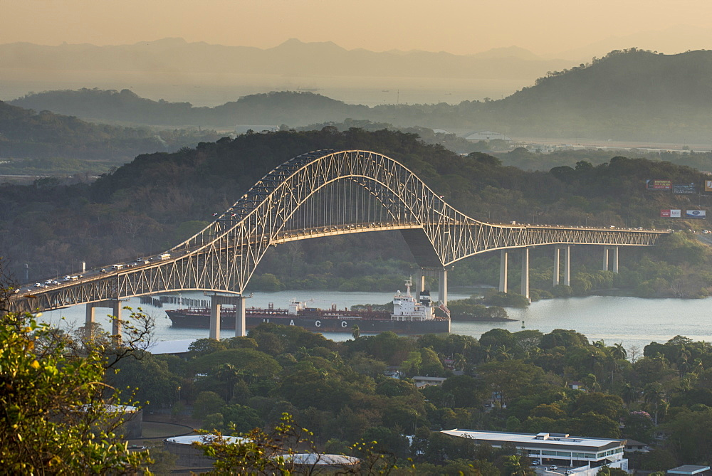 Cargo boat passes the Bridge of the Americas on the Panama Canal, Panama City, Panama, Central America