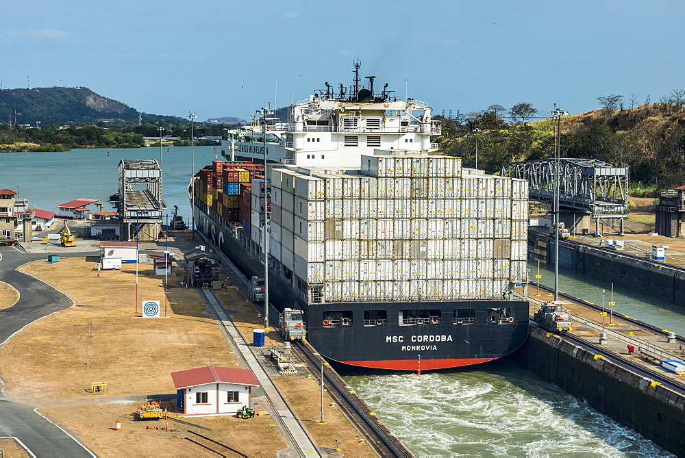 Cargo boat passing the Miraflores Locks, Panama Canal, Panama City, Panama, Central America