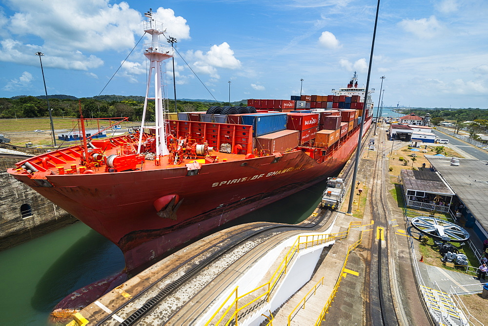 Cargo boats passing the Gatun Locks, Panama Canal. Panama, Central America