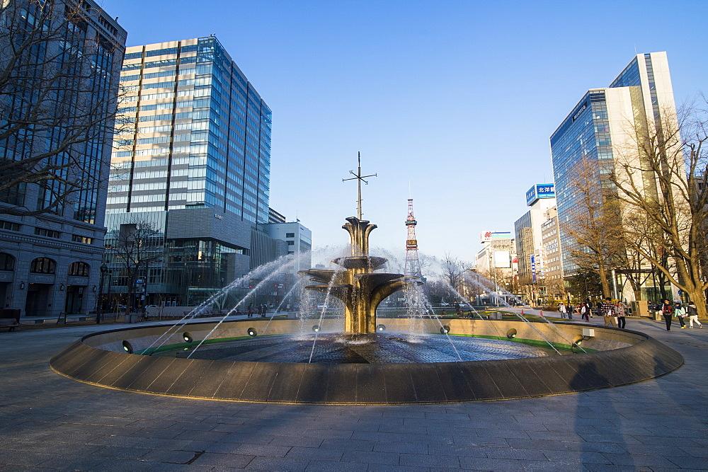 Fountain in the Odori Park, downtown Sapporo at sunset, Hokkaido, Japan, Asia