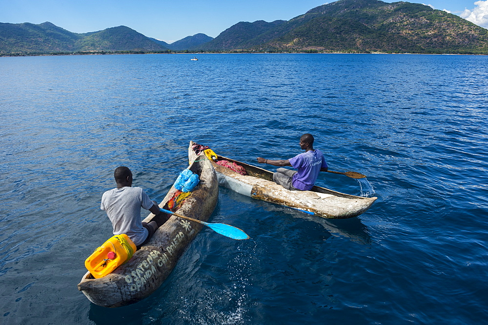 Fishermen on their canoes going fishing, Cape Malcear, Lake Malawi, Malawi, Africa