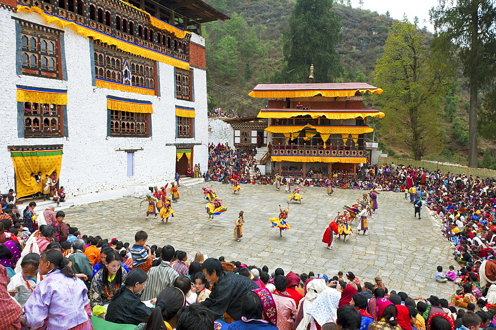 Crowds watching the dancers at the Paro festival, Paro, Bhutan, Asia - 1186-17