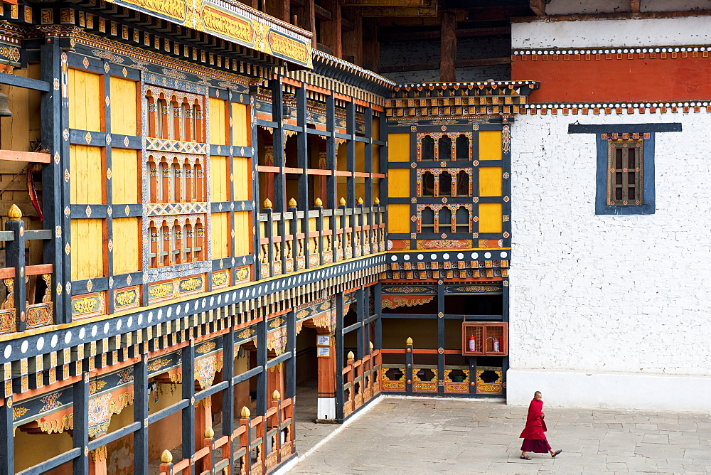 Monk walking through Rinpung Dzong, Paro District, Bhutan, Asia