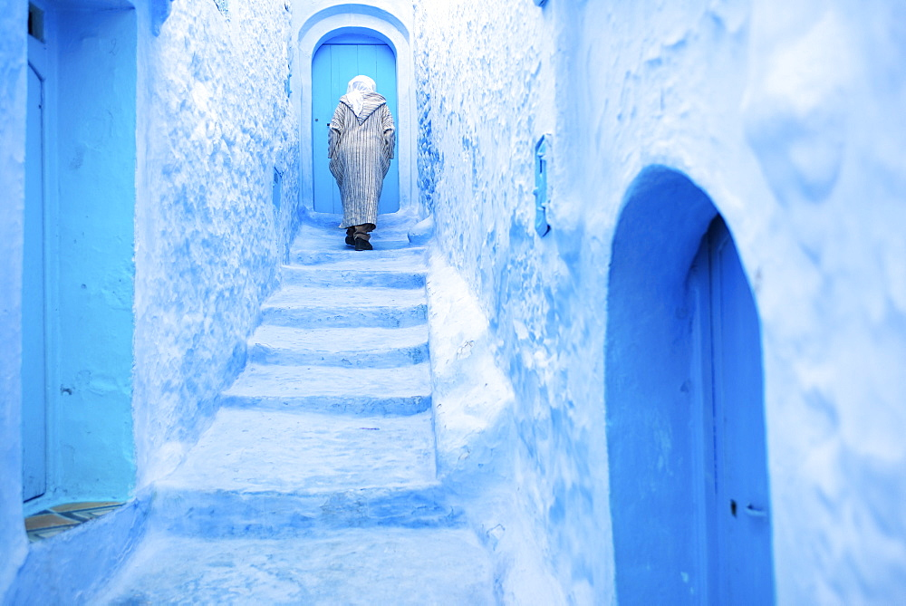 Local man in the blue streets of the Medina, Chefchaouen, Morocco, North Africa, Africa - 1186-40
