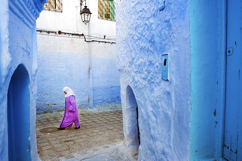 Local women walking through the blue streets of the Medina, Chefchaouen, Morocco, North Africa, Africa