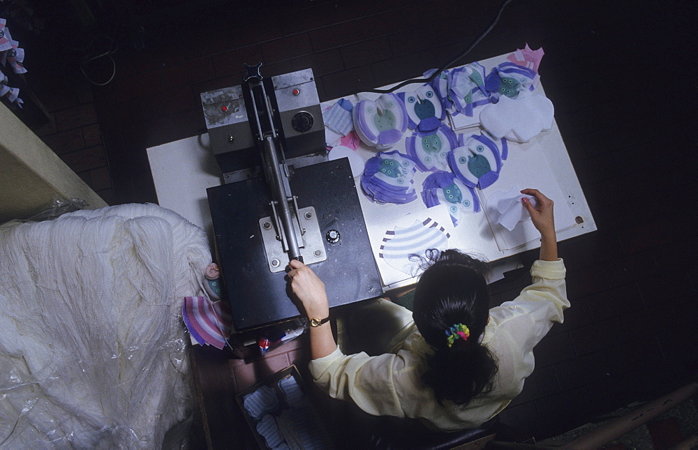 Toy manufacturer, colombia. Bogota. Pelanas ltda, manufacturer of soft toys. Woman sewing the soft toys. Small businesses are thought to generate about 25% of latin americas gnp