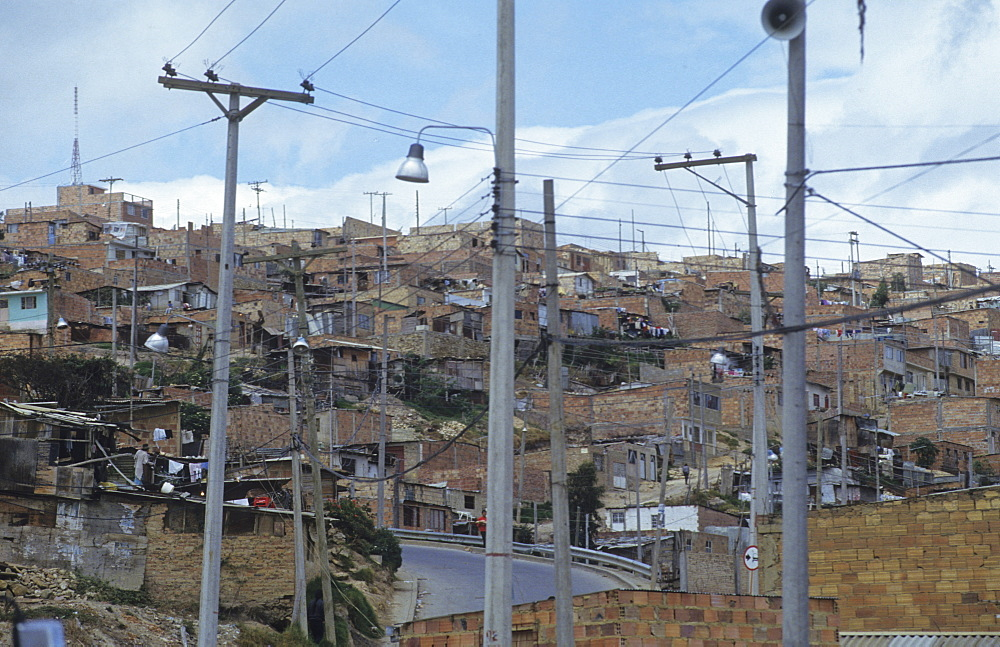 Slum, colombia. Bogota. Poor barrio in bogota, showing recently installed electricity and telephone lines