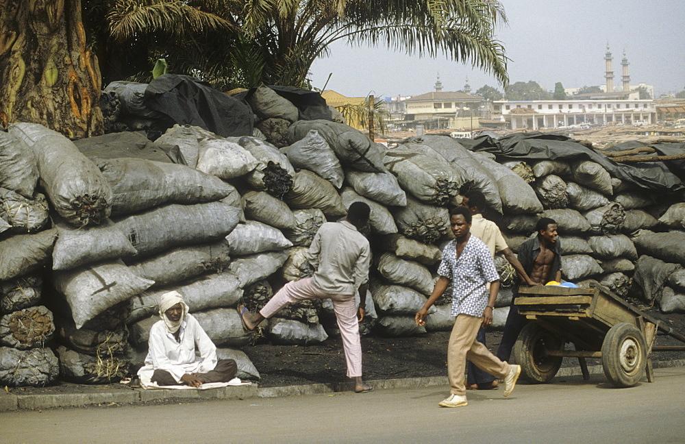 Charcoal market, cote d ivoire. Abidjan. Charcoal cooking fuel market