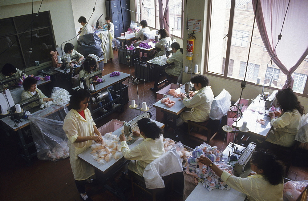 Toy manufacturer, colombia. Bogota. Pelanas ltda, manufacturer of soft toys. Women sewing the soft toys. Small businesses are thought to generate about 25% of latin americas gnp
