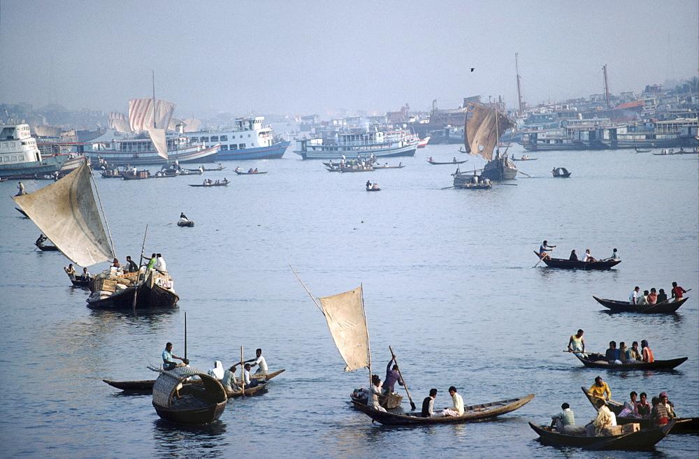 Ganga river - docks, bangladesh. Dacca. Sailing boats on the ganga river