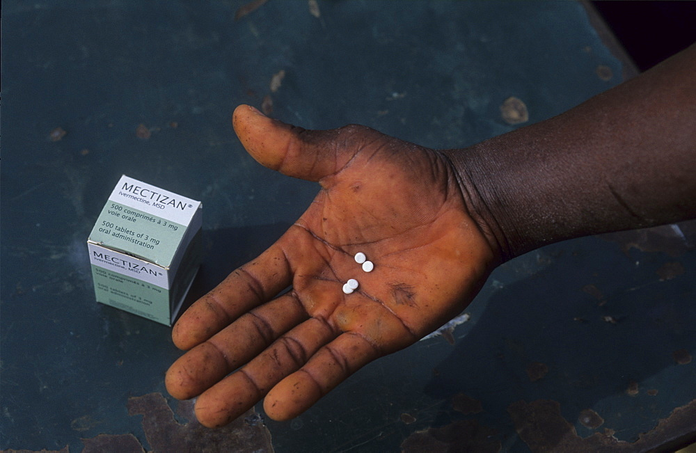 Onchoceriasis, ivory coast. Vicinity boake. Taking ivermectin tablets, the once a year prevention treatment for river blindness or onchoceriasis