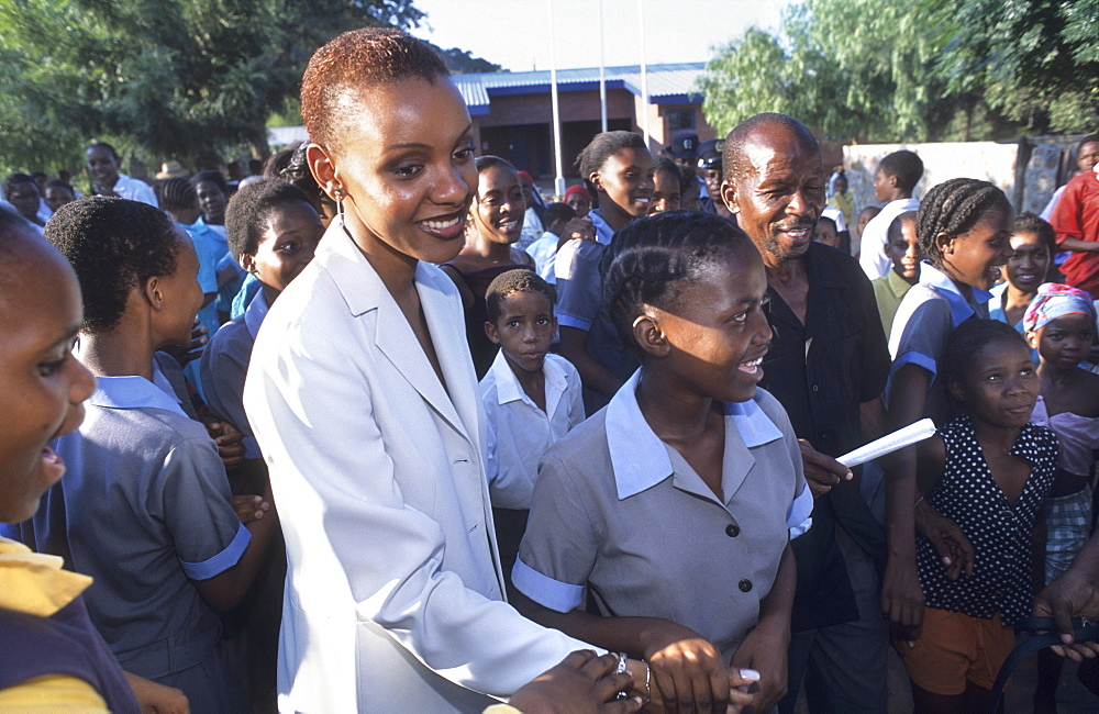 Aids education, botswana. Gaborone. Mpule kwelagobe, miss universe 1999 & unfpa goodwill ambassador warns students of the danger of contracting aids from unprotected sex