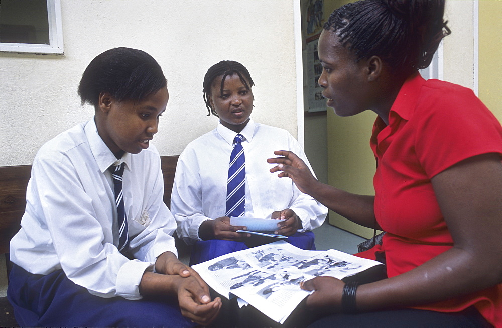 Aids counselling, botswana. Gaborone. A health counsellor warns schoolgirls about the danger of contracting aids from unprotected sex