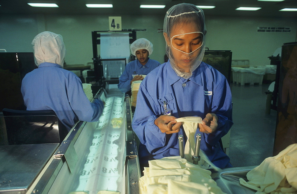 Surgical glove factory,malaysia. Penang. Tiger economy / women working.
