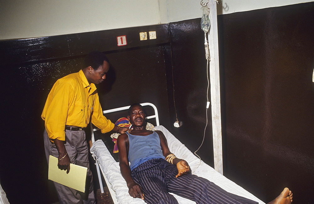 Daloa hospital, cote divoire. Dr f. Doua examining patient with sleeping sickness