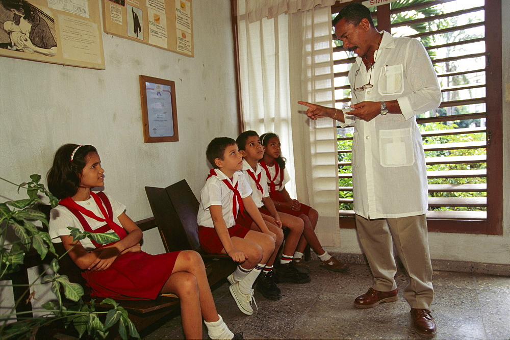 Cuba, havana. School children being taught health care