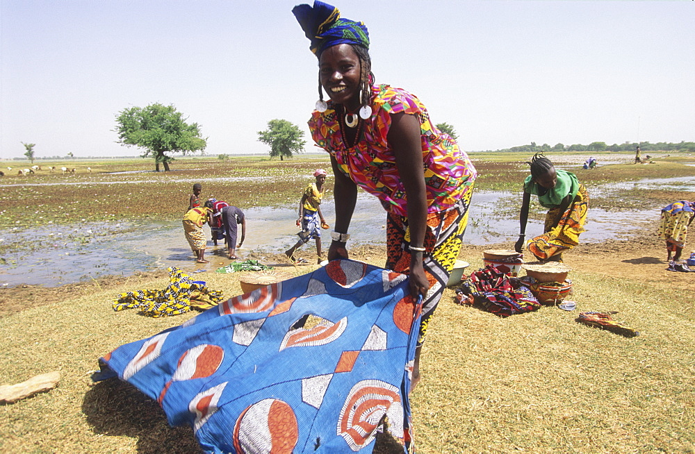 Washing clothes, burkina faso. Silmiougou village. Women washing clothes at the pond