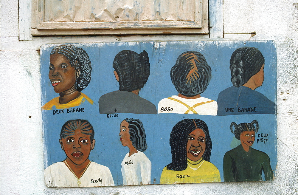 Burkina faso, traders signs. Ouagadougou. Hairdresser