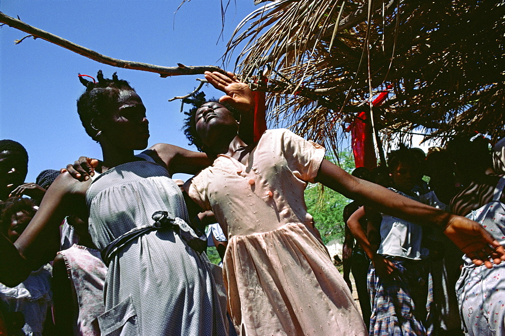 Voodoo, haiti. Thomazeau village. Possessed devotees in a voodoo ceremony. It uses drumming, singing, dance, and drugs to induce possession by spirits