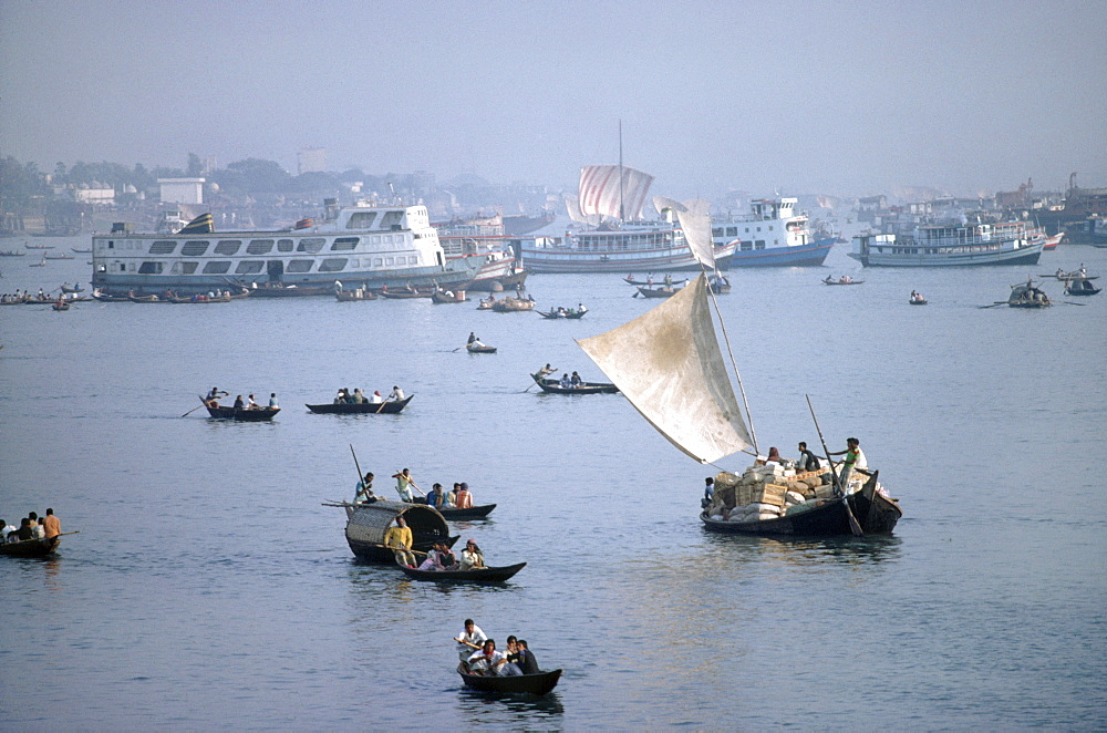 Ganga river - docks, bangladesh. Dacca. Sailing boats on the ganga river