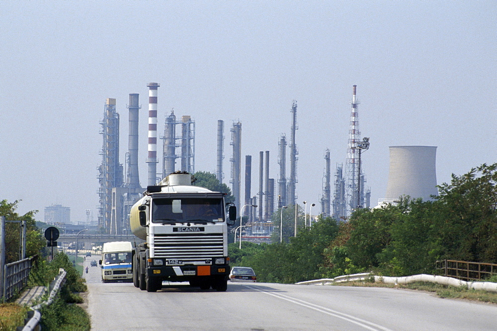 Italy., vicinity ferrara. A tanker transports gasoline from an oil refinery. 90% of transport in italy is by road