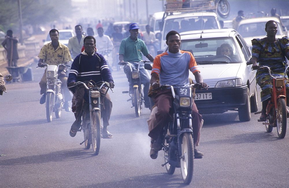 Pollution, burkina faso. Ouagadougou. Pollution from thousands of mopeds turns the air blue