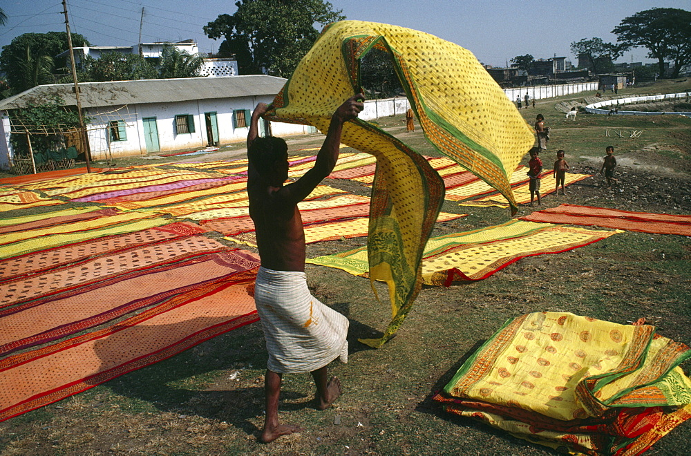 Bangladesh, dacca. Drying saris in the sun