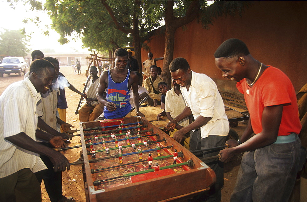 Children, burkina faso. Ougadougou. Children playing table football