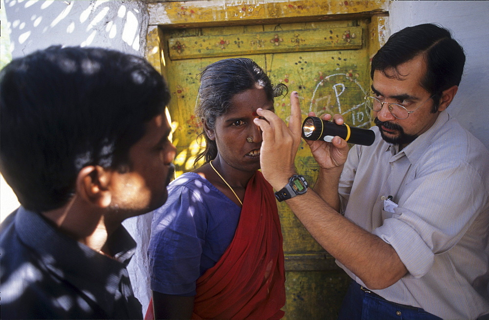 Health, india. Andhra pradesh, rishi valley. Centre for new education. Doctor examining womans eyes for cataracts.