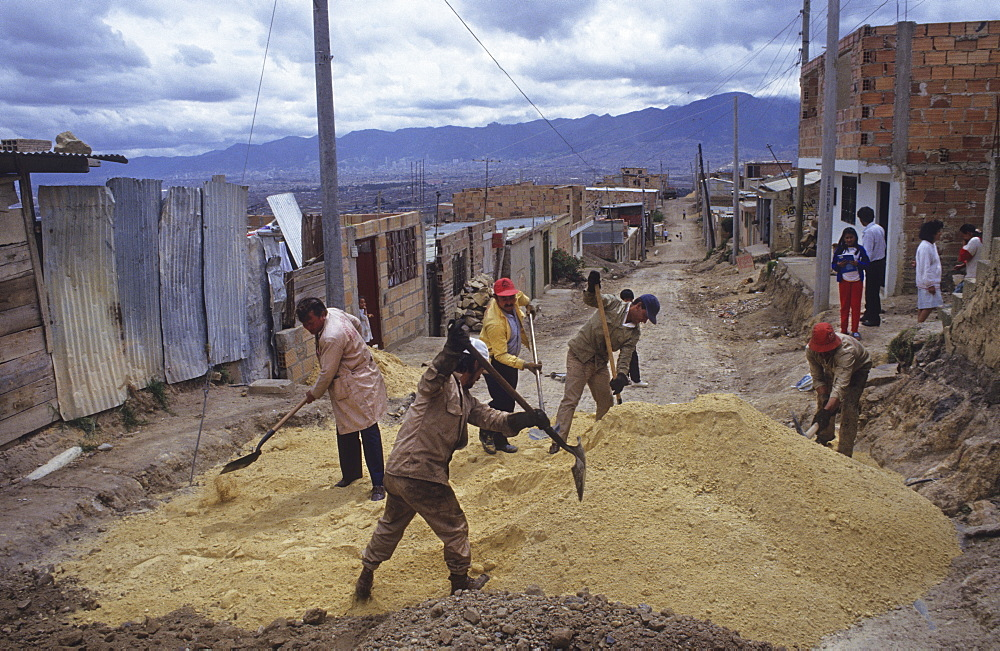 Road construction, colombia. Bogota. Improving roads in the poor barrio