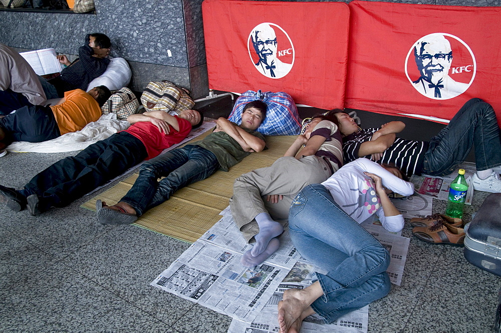 China migrant workers from the countryside waiting outside guangzhou train station, guangdong province