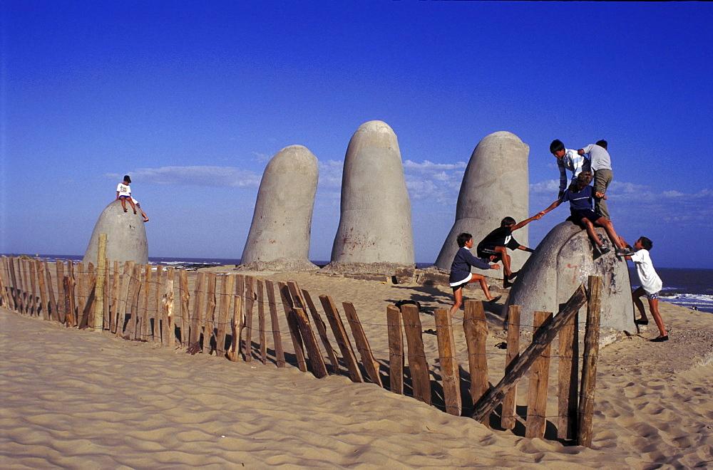 Uruguay. Punta del este, playa brava. Children playing