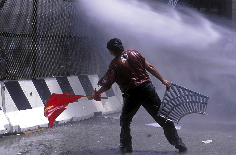 Protest, italy. Demonstrators soaked by polices water cannon during the g8 summit in genoa