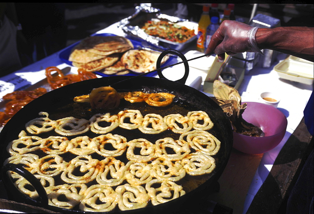Street kitchen, bangladesh. Dhaka. Food stall selling fried phokaras
