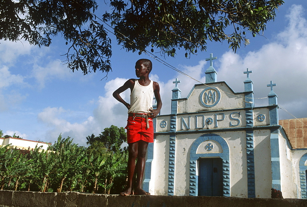 Haiti. Young boy in a cemetery in port-au-prince