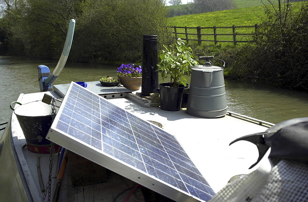 Solar energy, uk. Wiltshire, the kennet and avon canal. Solar power usd on a canal boat