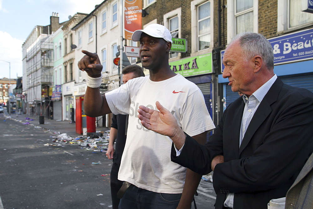 Labour party candidate for mayor of london ken livingston inspects damage to property after rioting and looting in croydon, london, uk