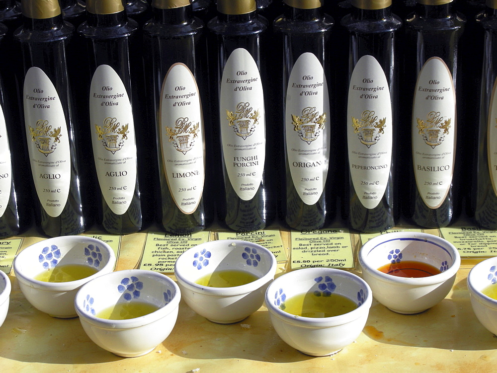 Uk olive oil and balsamic vinegar for sale at a stall at broadway market in east london