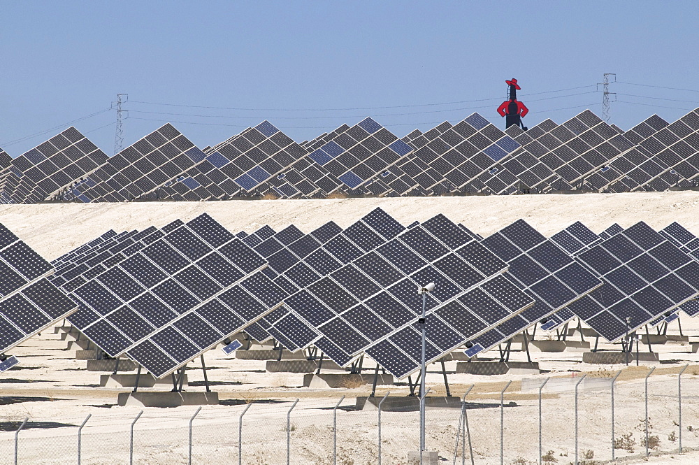 Spain.solar panels creating renewable energy from the sun, with a cut,out for tio pepe sherry near jerez in andalucia
