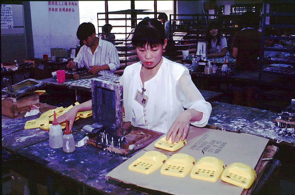 China, working with solvents without protection at toy factory, guangdong province.