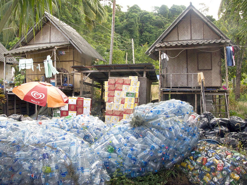 Thailand, recycling bottles and cans at a tourist resort on the island of ko chang