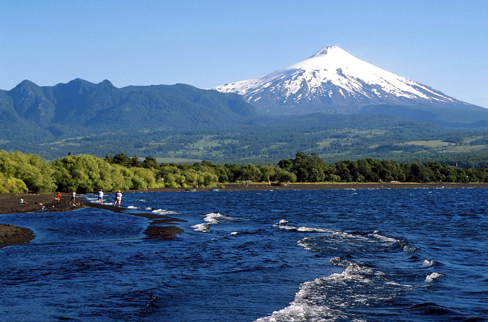 Chile, tourists visiting the osorno volcano and lake in the southern region.