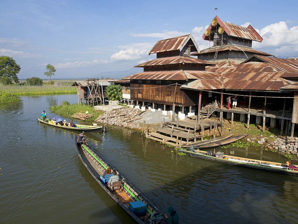 Tourists arrive by boat at monastery on Inle Lake, Shan State, Myanmar (Burma), Asia