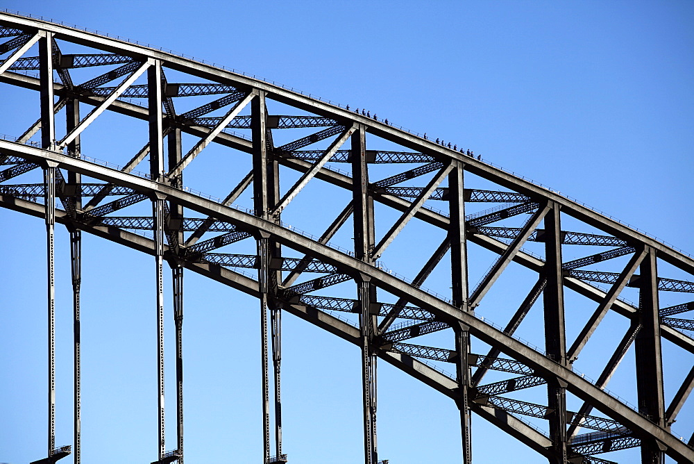 The Harbour Bridge, with tourists walking on top. Sydney, Australia