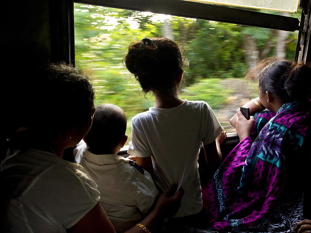 Passengers on a train in Sri Lanka, Asia