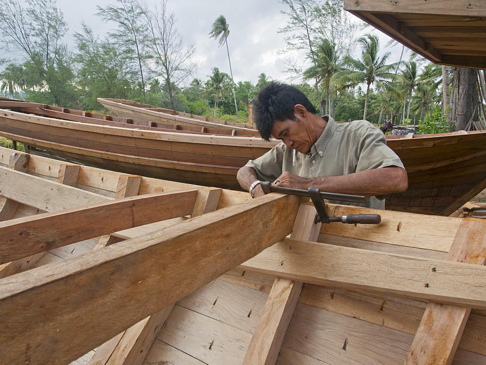 Craftsman making a fishing boat on Bintan island, Sumatra, Indonesia, Southeast Asia, Asia