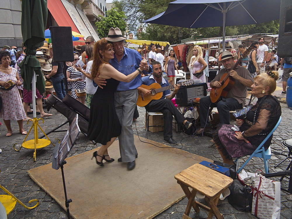 Tango dancers and musicians in the streets of the old barrio of San Telmo, Buenos Aires, Argentina, South America