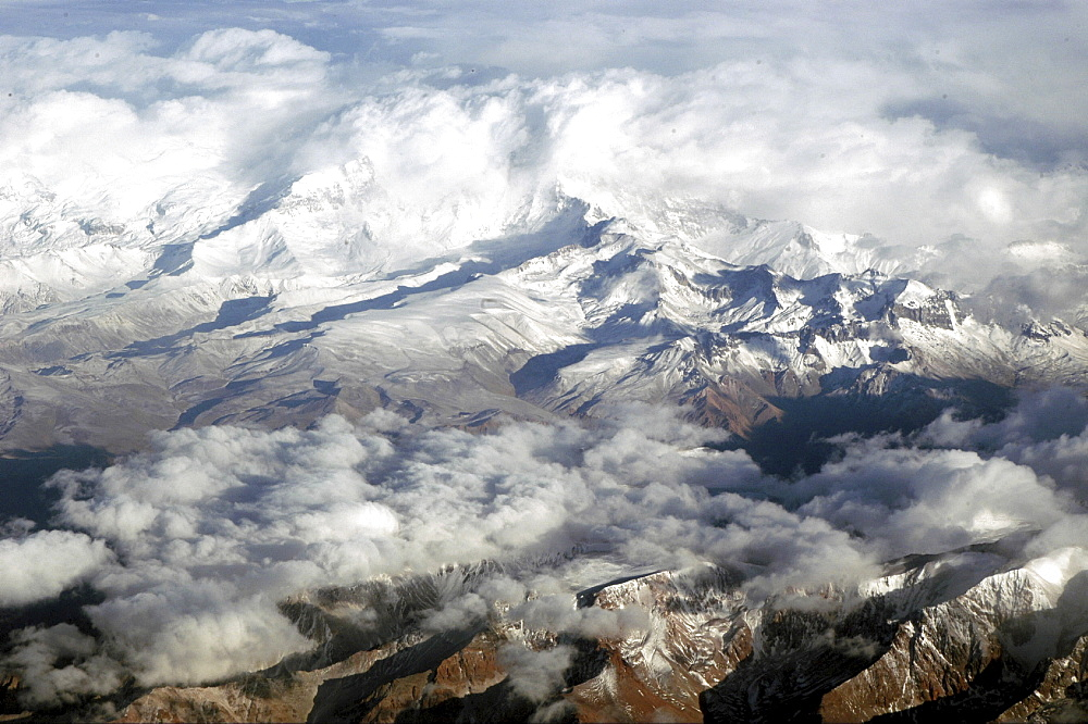 Andes, chile. View over the andes mountains, towards the argentinian border. Near mauna kea (world s tallest mountain). Storm clouds approach the mountains